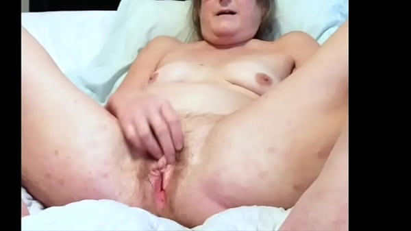 mature milf plays with her big clit and fingers wet pussy