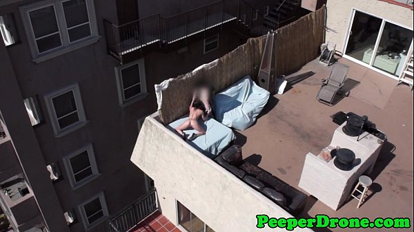 Drone films rooftop sex