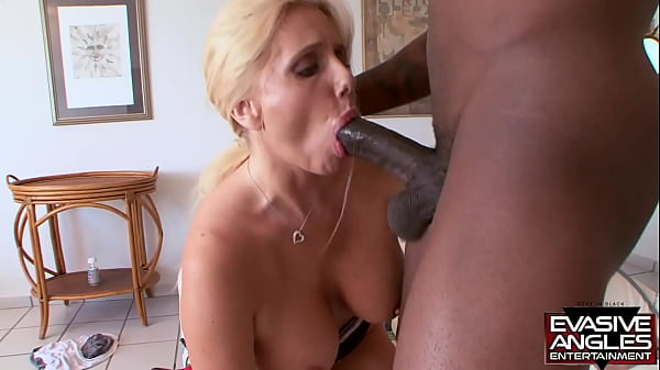 EVASIVE ANGLES Voluptuous blonde Karen Fisher takes charge and shows lucky Scorpio just what mama likes as she takes his load all over her big beautiful tits Thumb