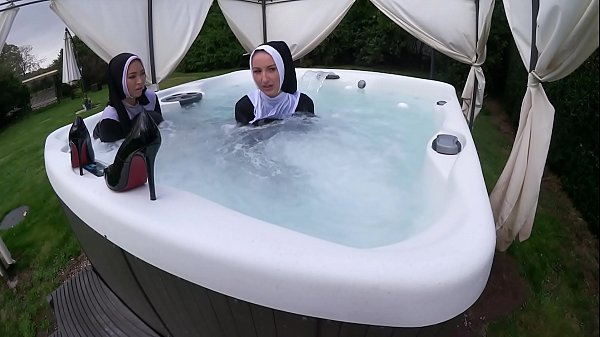 Two Naughty Nuns Get Wet In The Hot Tub