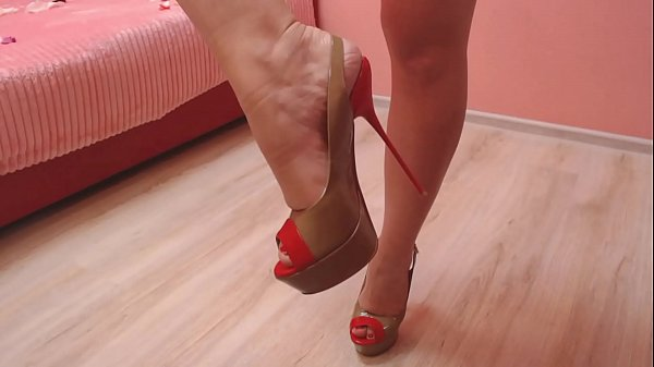 Nice collection of high heels and teasing with them. Thumb