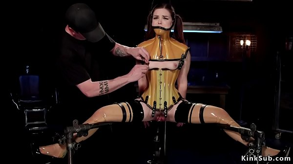 Brunette in rubber lingerie in device bondage Thumb