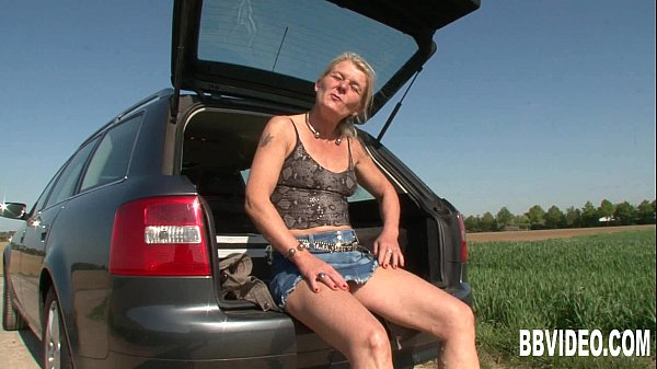 German milf masturbating outdoors