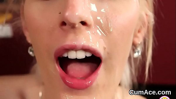 Foxy beauty gets cumshot on her face eating all...