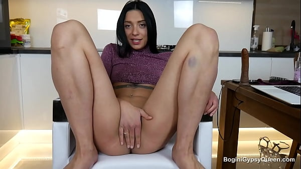 This wholly delicious brunette looks so amazing in a sexy pulled up purple blouse and big dildo in her ass