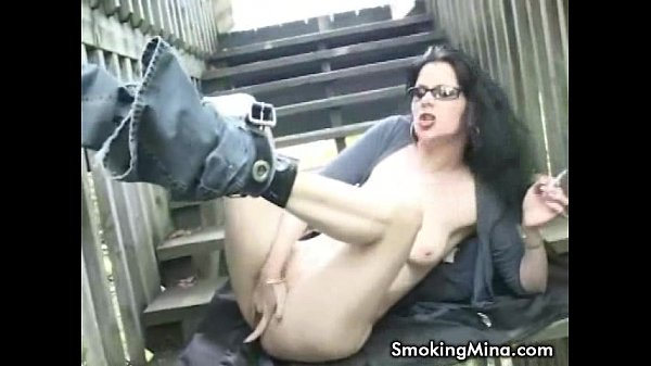 Horny brunette fingering her pussy while smoking in the stairway Thumb