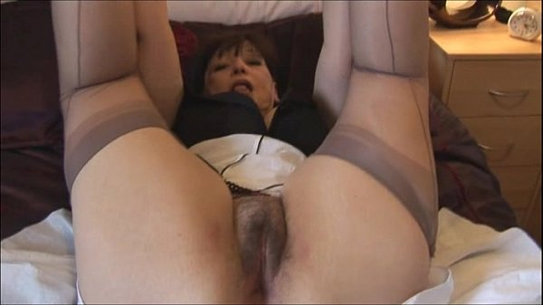 Busty hairy mature with nice curves strips and poses