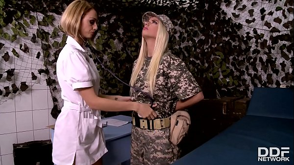 Sexy military nurse Erica Fontes licks sexy soldier Jessie Volt's pussy