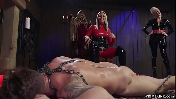 Femdoms in latex pegging man slave