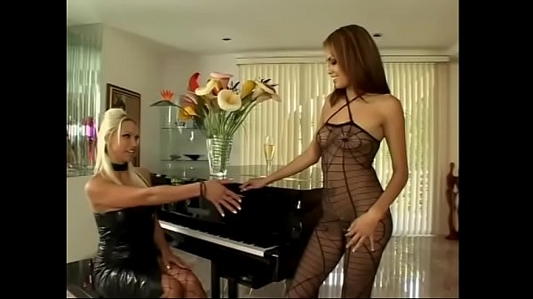 Young Latin hottie Daisy Marie likes to shoove glass dildo in the round ass of stunning blonde latex slut Nicki Hunter while she was frigging her twat instead of playing piano