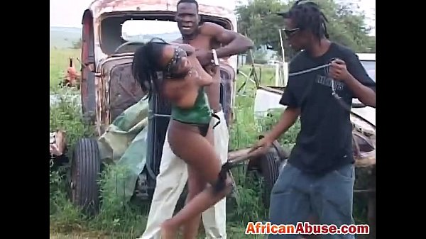 Enchained African babe gets abused by two horny black guys Thumb