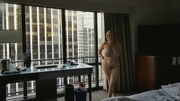 Mature hottie naked in hotel window