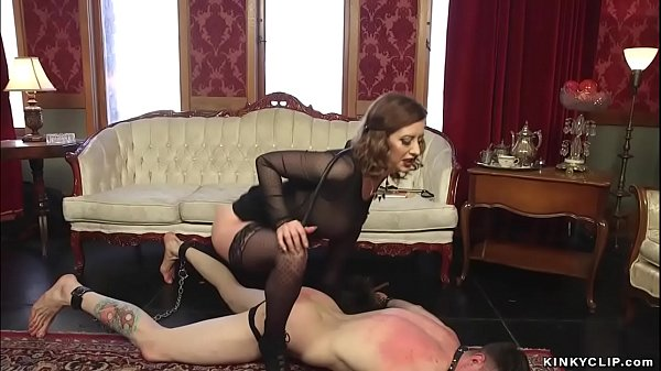 Busty dominatrix pegging submissive man