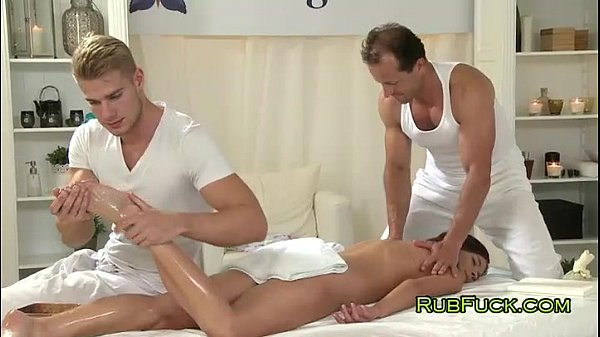 Brunette gets fucked by two masseurs Thumb