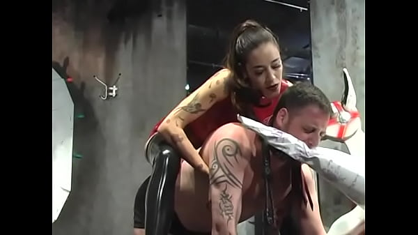 Slutty chick in a red suit pours melted wax on a horny dude's chest and then rides it