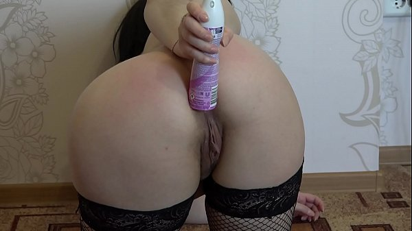 Anal masturbation with a bottle of deodorant and a gaping ass. Brunette in stockings shows her legs, masturbates her hairy pussy, and fucks booty. Homemade fetish and foot fetish. Thumb