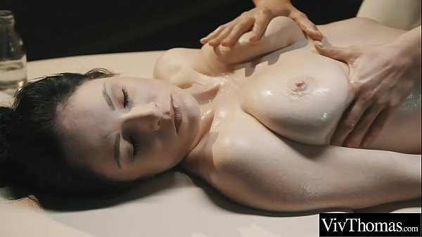 Busty beauty gets a naked massage from sexy lesbian. See the gorgeous masseuse caress her client's big natural breasts