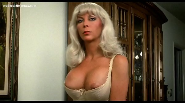Angelique Pettyjohn making out and getting her big boobs fondled in Biohazard (1985) Thumb