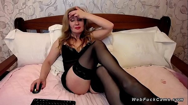 Milf in brunette lingerie on webcam