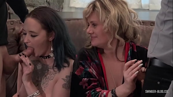 Hot amateur swinger sluts sucking cock in foursome orgy