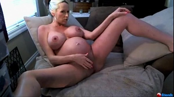 Pregnant Milf on cam fingers her pussy