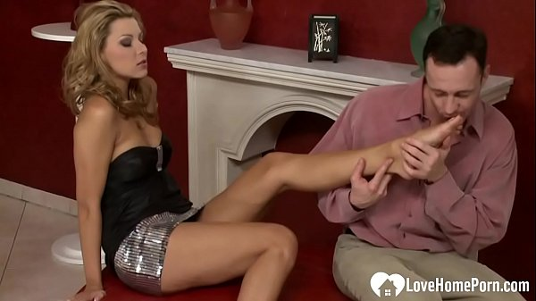 Using her feet to please cock after sex