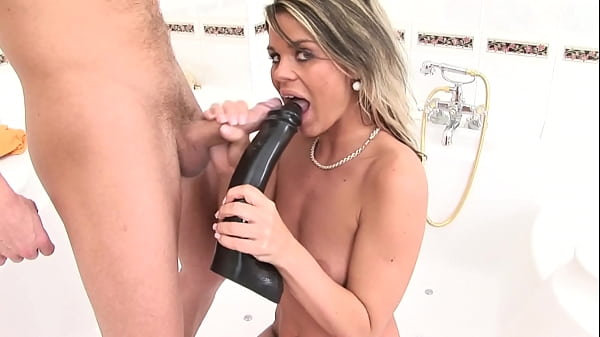 Man takes a shower and she sucks a big rubber cock waiting to be fucked