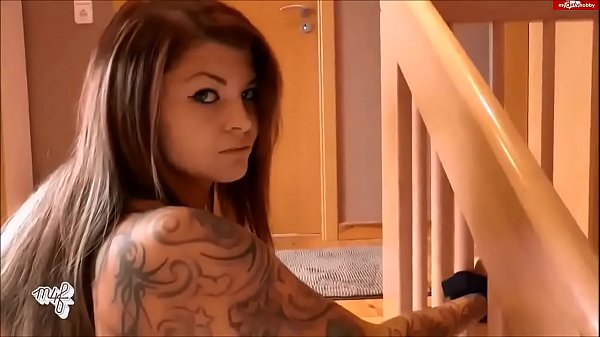 Busty tattooed brunette tied and fucked on the stairs