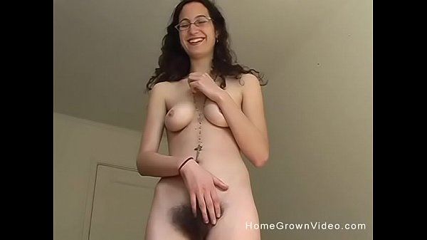 Hairy brunette with a petite body masturbates with a toy