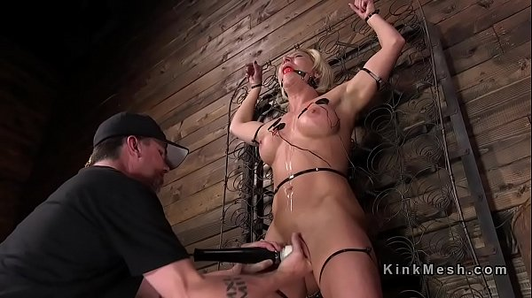 Busty submits to pussy vibe in bondage