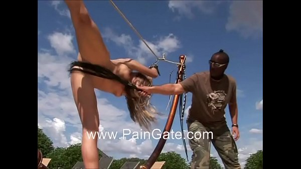Leggy paingate model stretched and whipped unde...