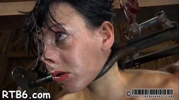 Fastened up beauty receives tongue and facial castigation Thumb