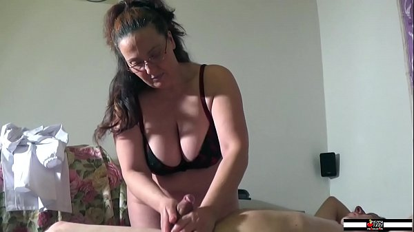 Mature busty masseuse wildly wanking a cock