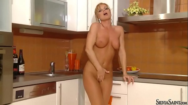 Stunning blonde milf Silvia Saint with perfect body in high heels only stuffs her sweet pussy in kit