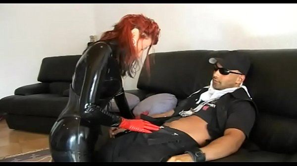 Hot redhead girl in latex seduces a worker Thumb