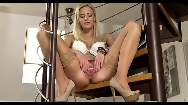 Blonde pissing from staircase