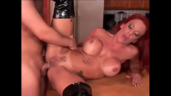 Anal loving redhead with huge breasts loves getting pounded on the kitchen bench
