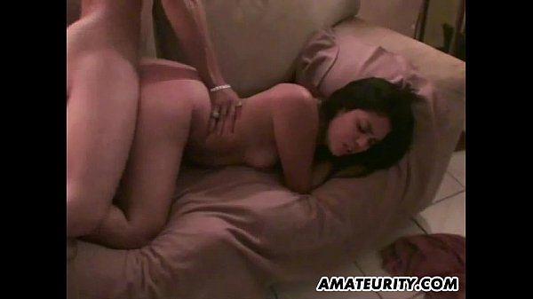 Young amateur couple doing it in the living room with facial