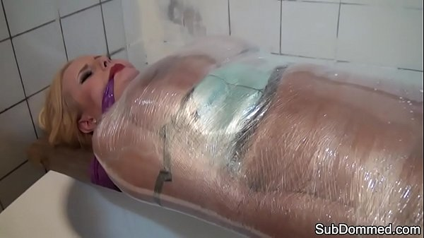Humiliated beauty restrained by kinky master