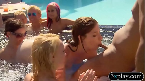 Group of swingers having fun by the pool Thumb