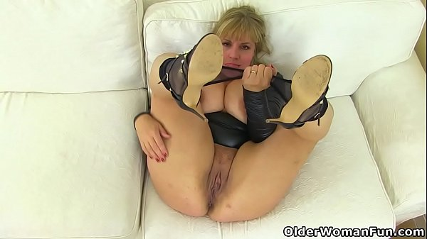 English milf Danielle looks close to perfection in a black dress Thumb