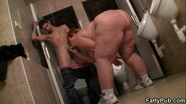 Huge lady takes it from behind in the public restroom