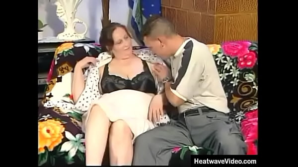 Muscular boy spreads granny's chunky thighs and fucks her hard