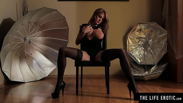 Beauty with huge natural tits masturbates in stockings and heels