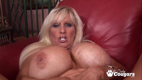 Cougar With Huge Phony Knockers Swallows A Big Load - Tia Gunn