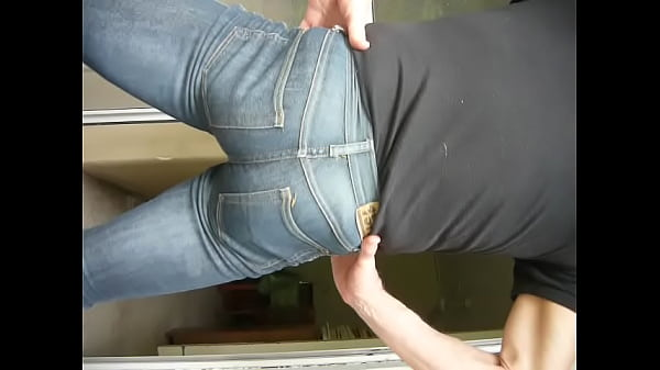 Arse flexing in tight jeans