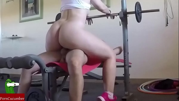 They fuck on the weight machine and he cums on her tits. SAN089