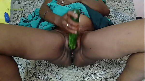 Busty prostitute pokes her pussy with massive c...