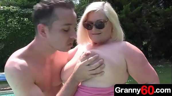 Grandson is busy cleaning the pool, but granny is her usual horny self, so the sight of this young hunk working hard in the sunlight is too much to bear
