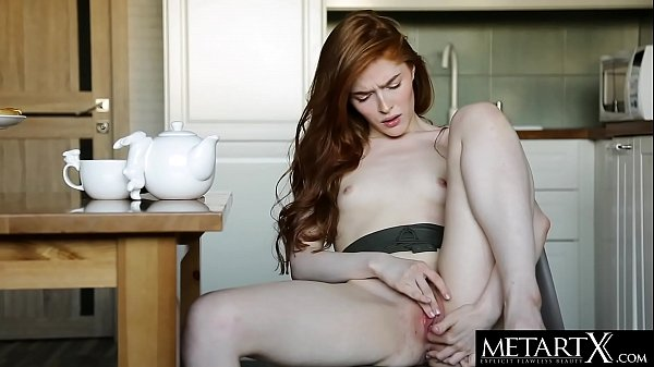 Sexy redhead rubs her natural red bush as she m...
